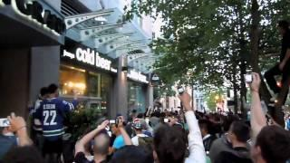 Flash Bang grenade explodes in a crowd during Vancouver 2011 riot...